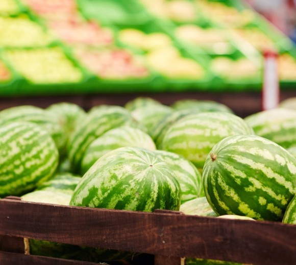Stack of watermelons in a grocery store